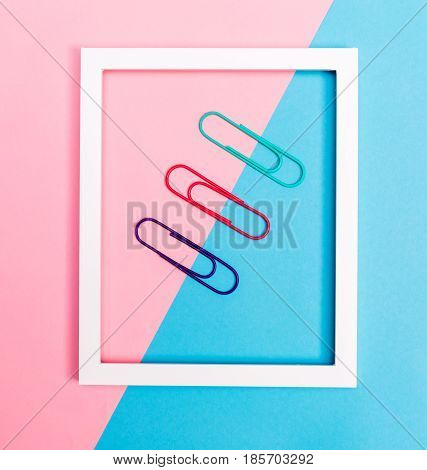 Big Paper Clips On A Vibrant Background