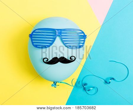 Party Theme With Balloon, Moustache And Shutter Shades