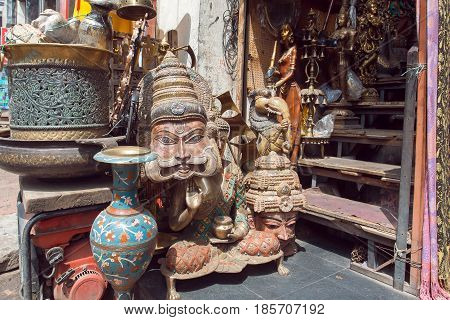 BANGALORE, INDIA - FEB 14, 2017: Traditional indian masks in store with vintage furniture art and antiques on February 14, 2017. With population 8.52 million Bangalore is 3rd most populous indian city