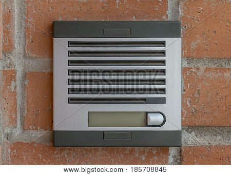 image of intercom on the brick wall background