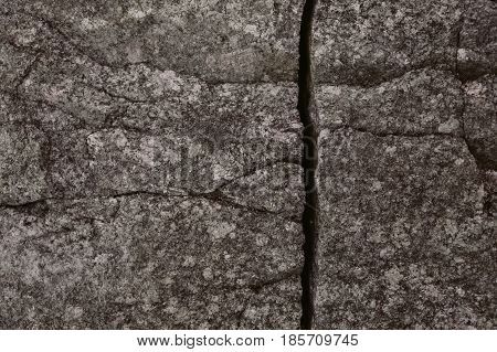 Old broken wall background.  Broken stone background. Abstract texture and background for designers. Stone wall textured. Close up view of aged stone wall. Rough texture.