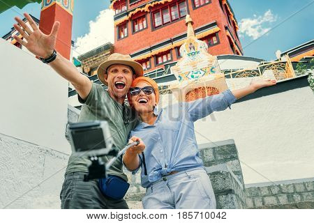 Happy couple take a self photo on the tibetan sight background