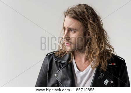 Young Handsome Man In Black Leather Jacket Isolated On Grey