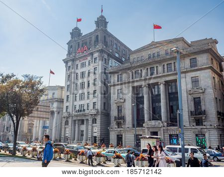 Shanghai, China - Nov 4, 2016: View of Chartered Bank, North China Daily News (AIA) and Taiwan Bank buildings (right to left) along The Bund on Zhongshan East 1st Road.