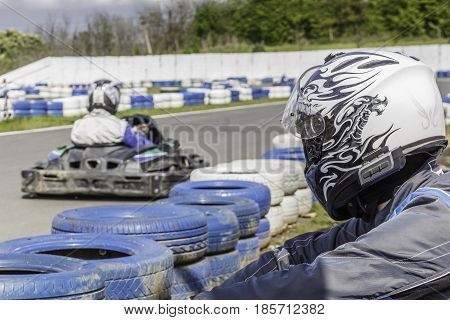 Karting Championship. Driver is watching for karting race.