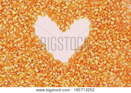 The dried corn kernels are heart on a white background.