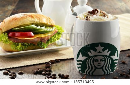 Composition With Cup Of Starbucks Coffee And Sandwich