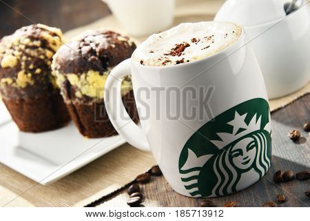 Cup Of Starbucks Coffee And Muffins