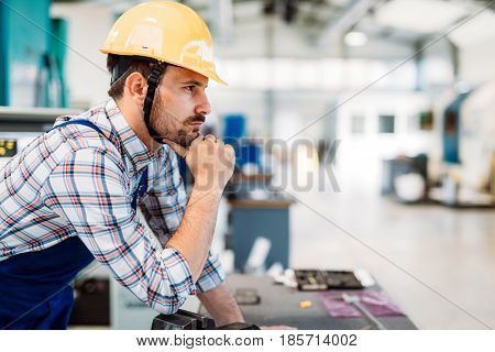 industrial factory worker working in metal manufacturing industry