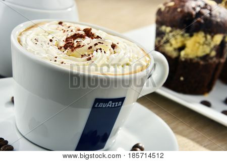 Cup Of Lavazza Coffee And Muffins