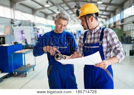 Mechanical and metal industry engineers working in factory