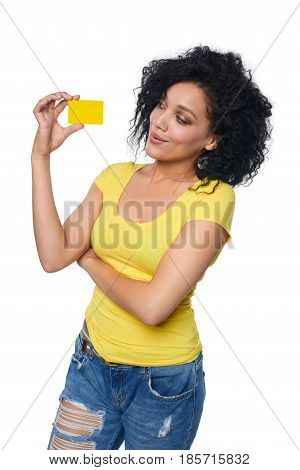 Smiling mixed race african american caucasian woman holding credit card isolated on white background