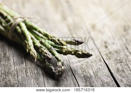 Fresh asparagus vegetable on rustic wooden table