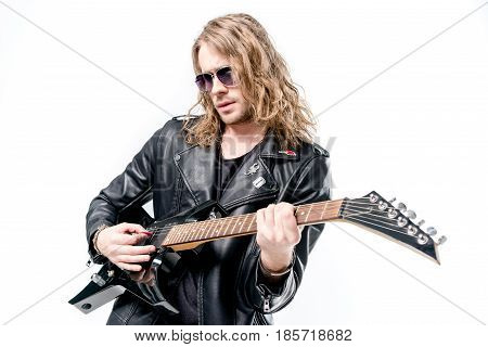 handsome rocker posing playing electric guitar isolated on white electric guitar player concept