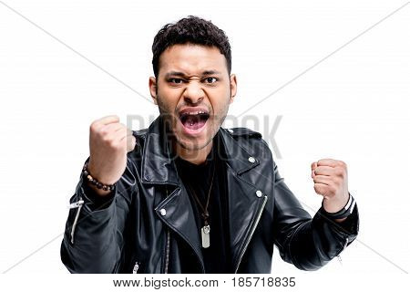 Portrait Of Emotional African American Rocker In Black Leather Jacket Posing Isolated On White