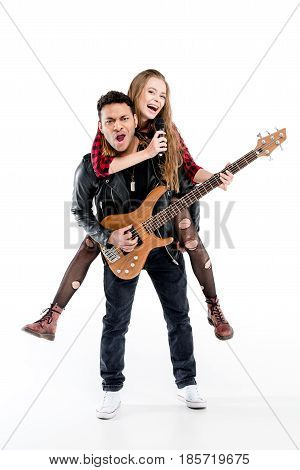Happy Young Couple Of Musicians With Microphone And Electric Guitar Performing Music Together Isolat