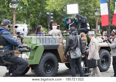 Paris. France. July 14, 2012. TV Correspondents cover events during the parade on the Champs Elysees in Paris.