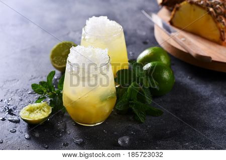 Cold pineapple cocktail with crushed ice lime and mint refreshing lemonade drink