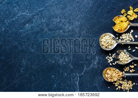 Various Cereals In Spoons