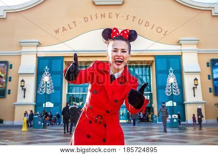 Happy Woman In Front Of Disney Studio 1 Showing Thumbs Up