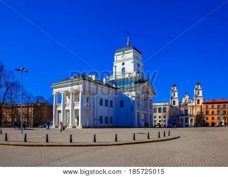 Minsk Belarus Roman Catholic Church The Cathedral of the Virgin Mary and the Town Hall building near Freedom Square. 12/04/2017 editorial