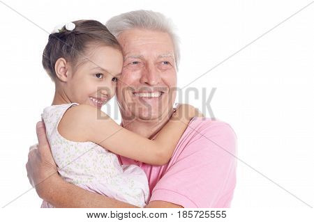 Portrait of grandfather and little granddaughter on white background