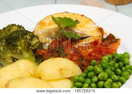 Cooked hake steaks Cooked hake steaks with freshly cooked vegetables