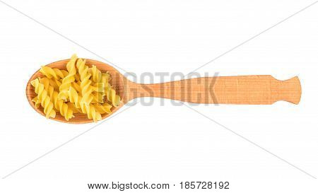 Wooden spoon filled with pasta fusilli on white background, top view
