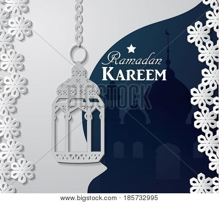 Arabic illustration of Ramadan Kareem on white and blue paper with Silhouette of mosque and paper light
