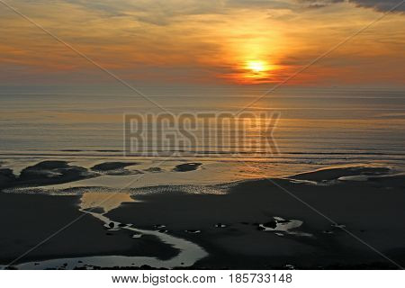 Sun setting over the English Channel in France