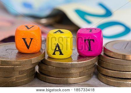 VAT letter cubes on coins concept picture
