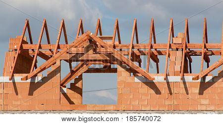 Unfinished building of a residential building with a truss on the construction site