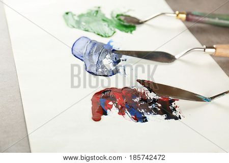 Palette knives with paint on paper