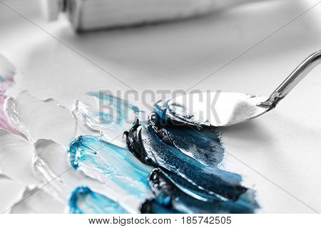 Palette knife and oil paints, closeup