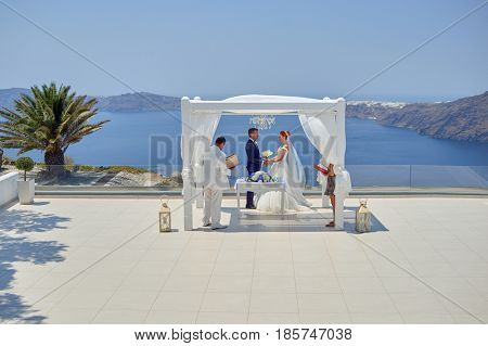 SANTORINI, GREECE - AUGUST 05, 2015: wedding ceremony on Santorini