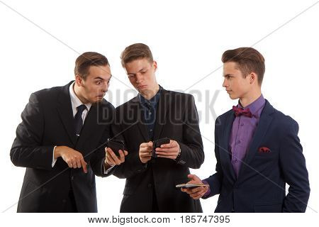 Guys in suits reacting to something on the phone