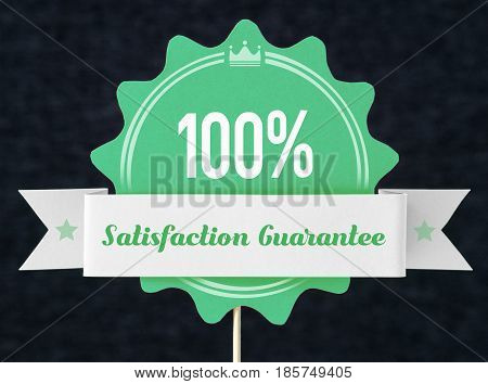 100% satisfaction guarantee badge cut from cardboard and paper on a wooden stick. Green banner, seal and ribbon for business website to promise customer the best premium quality product or service.