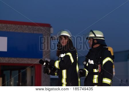 Hamburg, Germany - April 18, 2013: Hdr - Firefighter And Firefighter In Action With Firehose