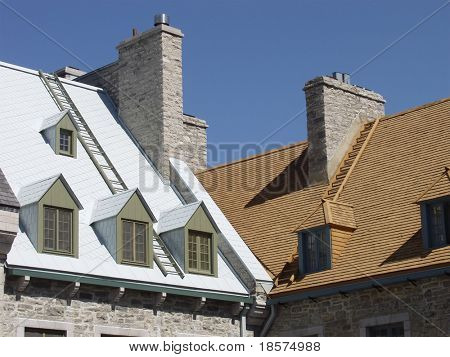 Roofs of two traditional stone houses in the heart of Old Quebec City, Quebec, Canada.