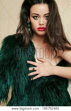Gorgeous Woman With Dark Hair In Luxurious Fur Coat