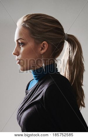 Woman profile with ponytail and natural makeup