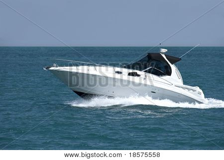 A white speedboat at the height of summer.