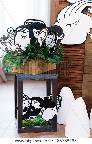 Vintage lantern, decorated with paper heads for wedding
