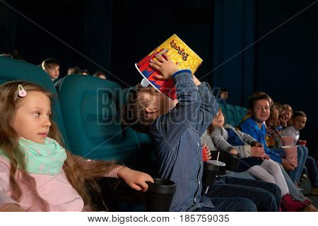 Shot of a little boy enjoying eating popcorn at the cinema children people lifestyle childhood kids positivity care free food snack corn tasty entertainment holidays activity concept.
