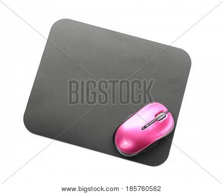 Modern wireless mouse and pad on white background