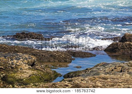 Close Up Ocean Waves Breaking On Coastal Shoreline