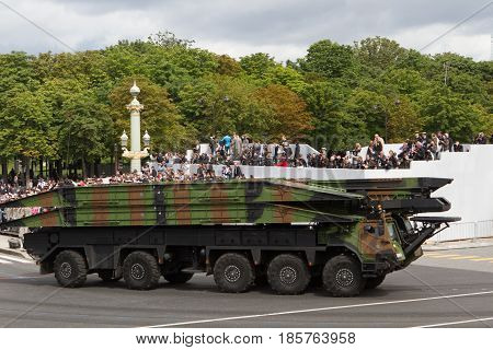 Paris France - July 14 2012. Procession of military equipment during the military parade in honor of the Bastille Day on the Champs Elysees in Paris.