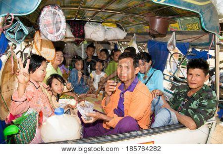 MINGUN, MYANMAR-MARCH 6, 2017: Burmese people on the light trucks in Mingun on March 6, 2017, Myanmar.