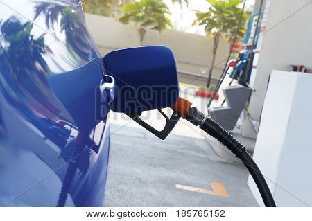 Fuel nozzle to refill fuel in car. - Concept energy