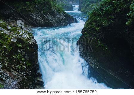 Water cascades at Vintgar canyon in slovenian Alps, Slovenia